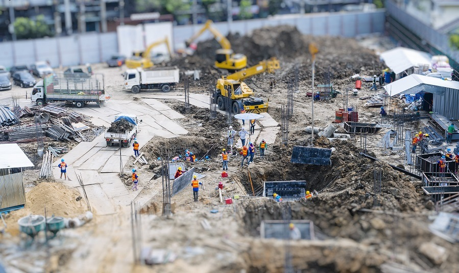 Construction site outdoor with Crane and People working